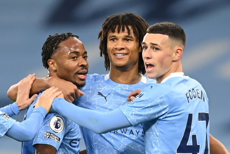 Sterling strike sinks Arsenal as Man City keep it tight