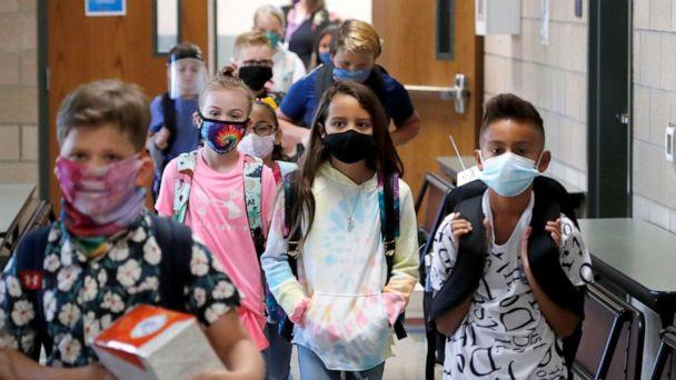 PHOTO: Wearing masks to prevent the spread of COVID19, elementary school students begin their school day in Godley, Texas, Aug. 5, 2020. (LM Otero/AP)