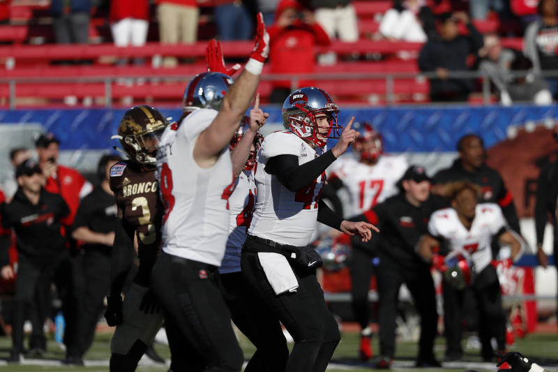 Western Kentucky place kicker Cory Munson, right, celebrates after kicking the game winning field goal in the final seconds of the NCAA First Responder Bowl college football game against Western Michigan in Dallas, Monday, Dec. 30, 2019. Western Kentucky won the game 23-20. (AP Photo/Roger Steinman)