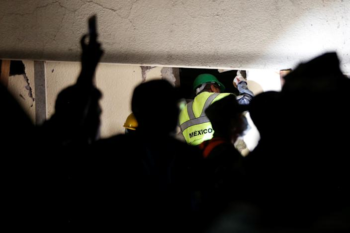 <p>A rescue worker searches through rubble in a floodlit search for students at Enrique Rebsamen school in Mexico City, Mexico Sept. 20, 2017. (Photo: Carlos Jasso/Reuters) </p>