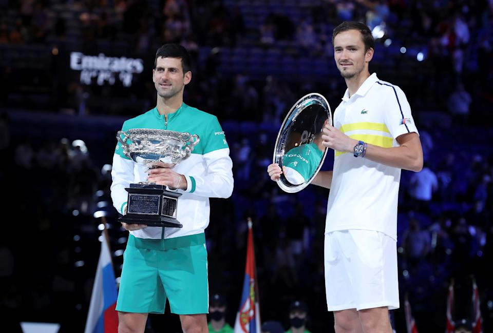Novak Djokovic (pictured left) and Daniil Medvedev (pictured right) pose for photos after their men's singles final at Australian Open in Melbourne Park in Melbourne, Australia, Feb. 21, 2021.