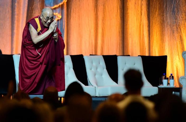 The Dalai Lama arrives at the Honda Center in Anaheim, California, on July 5, 2015, where the religious leader celebrated his 80th birthday (AFP Photo/Frederic J. Brown)