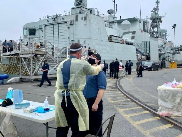 A crew member of HMCS Halifax gets a PCR test for COVID-19 Monday.  (Paul Palmeter/CBC - image credit)