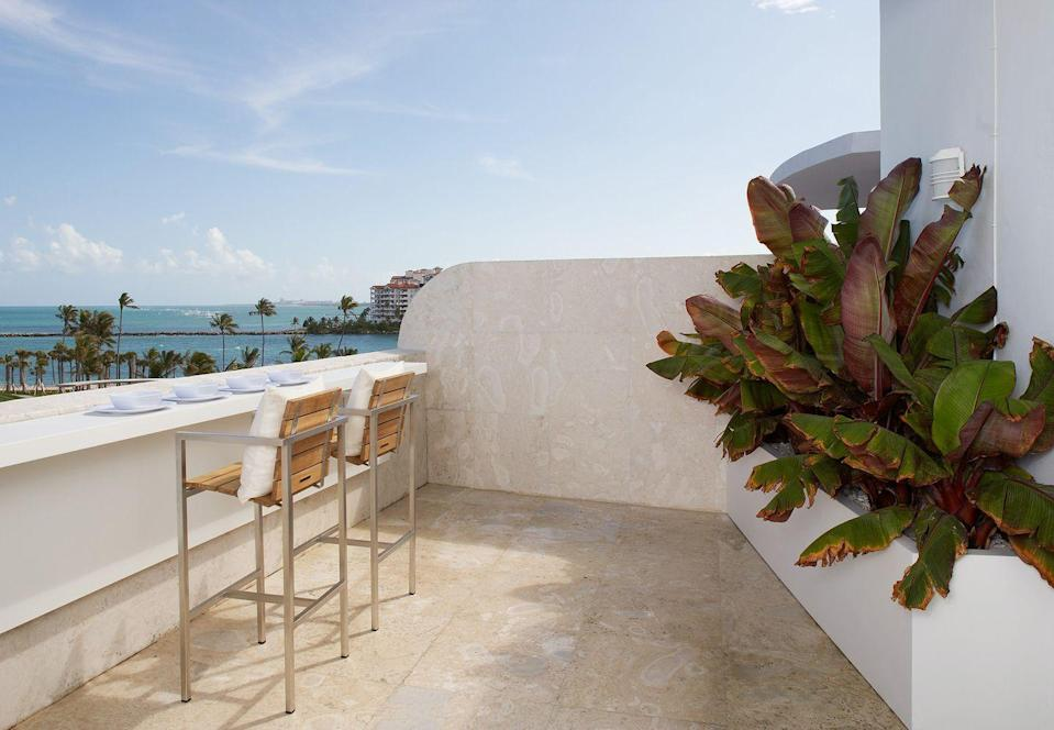 "<p>On this Miami rooftop terrace, bar stools are arranged for dinner with a view.</p><p><em>Design by <a href=""https://deringhall.com/interior-designers/magdalena-keck-interior-design"" rel=""nofollow noopener"" target=""_blank"" data-ylk=""slk:Magdalena Keck Interior Design"" class=""link rapid-noclick-resp"">Magdalena Keck Interior Design</a></em></p>"