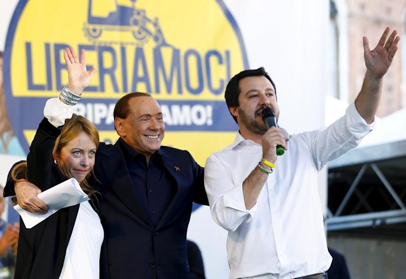 Forza Italia party (PDL) leader Silvio Berlusconi (C) stands with Northern League leader Matteo Salvini (R) and Fratelli D'Italia leader Giorgia Meloni during a Northern League rally in Bologna, central Italy, November 8, 2015. The Northern League, Italy's third largest political force, is planning a major rally to voice its opposition to the government of Prime Minister Matteo Renzi. REUTERS/Stefano Rellandini (Photo: Stefano Rellandini / reuters)