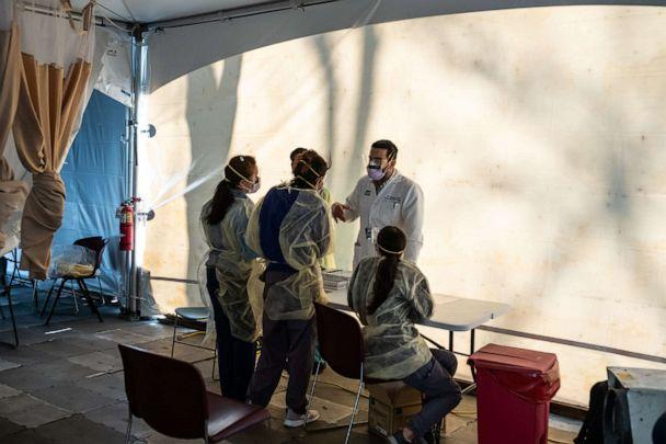 PHOTO: Doctors wait to test hospital staff with flu-like symptoms for coronavirus (COVID-19) in set-up tents to triage patients outside at St. Barnabas hospital in the Bronx borough of New York City, March 24, 2020. (Misha Friedman/Getty Images)
