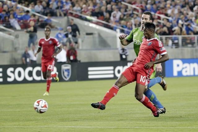 San Jose Earthquakes forward Yannick Djalo (10) shoots to score against the Seattle Sounders during the first half of an MLS soccer match Saturday, Aug. 2, 2014, in Santa Clara, Calif. (AP Photo/Marcio Jose Sanchez)