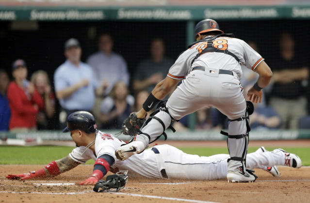 Cleveland Indians' Carlos Gonzalez is caught stealing home plate as Baltimore Orioles' Pedro Severino tags him out in the third inning of a baseball game, Thursday, May 16, 2019, in Cleveland. (AP Photo/Tony Dejak)