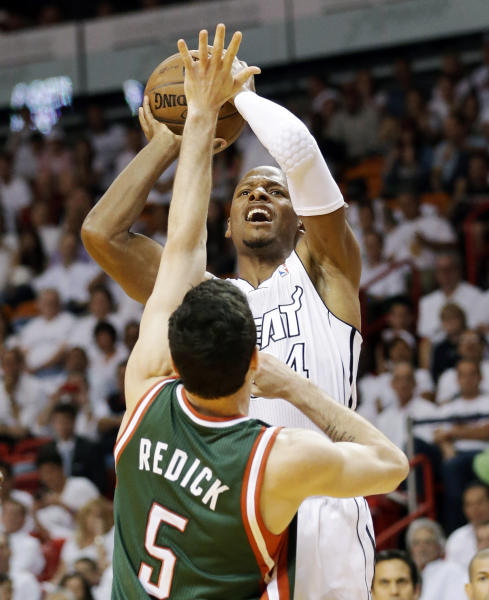 Miami Heat guard Ray Allen shoots against Milwaukee Bucks guard J.J. Redick (5) during the first half of Game 2 in their first-round NBA basketball playoff series, Tuesday, April 23, 2013 in Miami. (AP Photo/Wilfredo Lee)