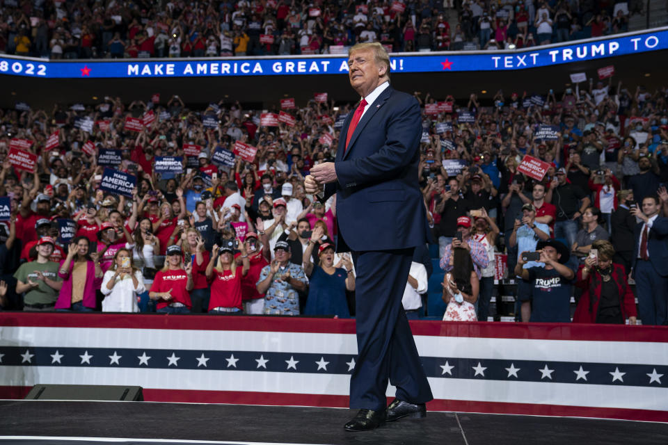 FILE - In this June 20, 2020, file photo President Donald Trump arrives on stage to speak at a campaign rally at the BOK Center in Tulsa, Okla. Trump is privately reassuring Republicans anxious about his deficits to Democrat Joe Biden, noting there are three months until Election Day and reminding them of the late-breaking events that propelled his 2016 comeback. (AP Photo/Evan Vucci, File)