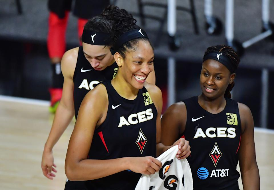 A'ja Wilson and Sugar Rodgers celebrate after a win.