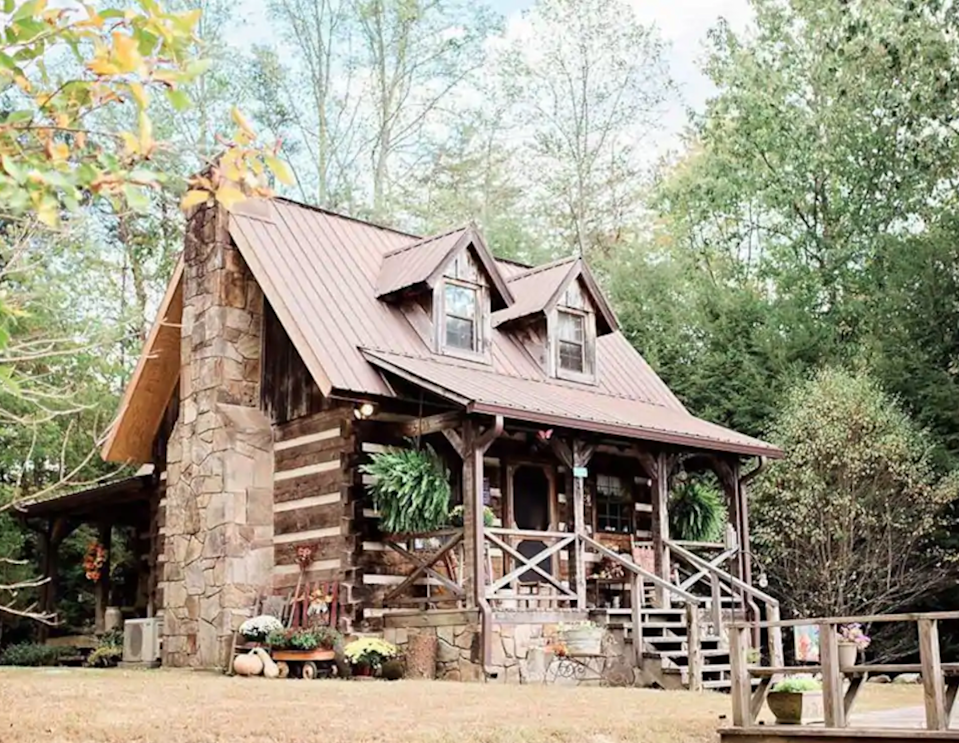 """<h2>South Cumberland State Park, Tennessee</h2><br><strong>Location:</strong> Sequatchie, TN<br><strong>Sleeps:</strong> 4<br><strong>Price Per Night:</strong> <a href=""""https://airbnb.pvxt.net/GjbzRk"""" rel=""""nofollow noopener"""" target=""""_blank"""" data-ylk=""""slk:$189"""" class=""""link rapid-noclick-resp"""">$189</a><br><br>""""This is a restored, rustic log cabin retreat directly on the bluff overlooking waterfalls and the Fiery Gizzard, which is a part of South Cumberland State Park, nestled on 8 private acres. The cabin perfectly blends vintage décor with modern amenities. Come enjoy peaceful mountain sunsets, countless local attractions/activities, and fine southern hospitality!""""<br><br><h3>Book <a href=""""https://airbnb.pvxt.net/GjbzRk"""" rel=""""nofollow noopener"""" target=""""_blank"""" data-ylk=""""slk:Hemlock Falls LLC. Bluff View Cabin"""" class=""""link rapid-noclick-resp"""">Hemlock Falls LLC. Bluff View Cabin</a></h3>"""