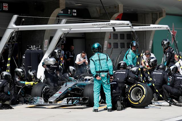 Formula One - F1 - Chinese Grand Prix - Shanghai, China - April 15, 2018 - Mercedes driver Valtteri Bottas of Finland sits in his car at a pit-stop during the race. Pool via REUTERS