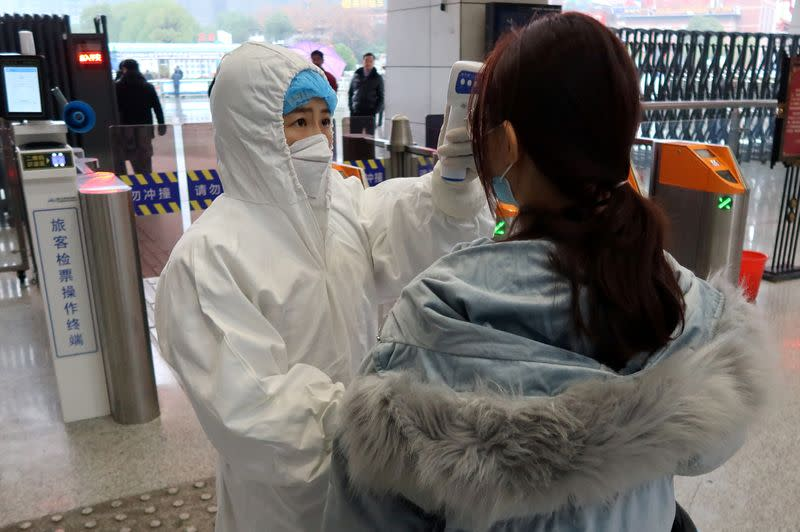 China to take stricter, more targeted measure to curb coronavirus spread - state TV