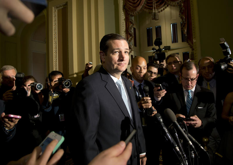 <p> Sen. Ted Cruz, R-Texas, pause as he speaks with reporters on Capitol Hill, Wednesday, Oct. 16, 2013, in Washington. Leaders reached a last-minute agreement to avert a threatened Treasury default and reopen the government after a partial, 16-day shutdown. Cruz said he would not try to block the agreement. (AP Photo/Carolyn Kaster)