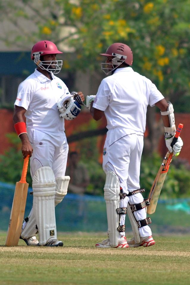 West Indies players N Deonarine and S Chanderpaul in action during Day 2 of practice match between West Indies and Uttar Pradesh Cricket Association XI at the Jadavpur University Ground in Kolkata on Nov.1 2013. (Photo: IANS)