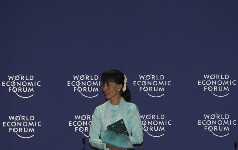 """Myanmar opposition leader Aung San Suu Kyi arrives to address the World Economic Forum on East Asia in Bangkok, Thailand, Friday, June 1, 2012. Suu Kyi urged the international community to exercise """"healthy skepticism"""" about her country's reforms as it sheds a half-century of military rule. (AP Photo/Sakchai Lalit)"""