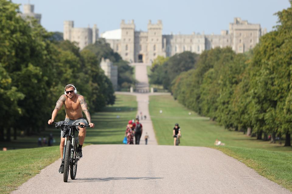 A cyclist travels along the Long Walk, Windsor, Berkshire, in the sunshine following the hottest August Bank Holiday Monday on record, where temperatures reached 33.2C. The heatwave is set to continue for some parts of the UK after the record-breaking bank holiday weather. (Photo by Jonathan Brady/PA Images via Getty Images)