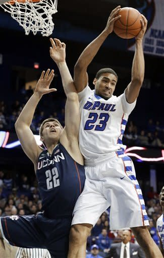 DePaul forward Donnavan Kirk, right, gets a rebound against Connecticut forward Leon Tolksdorf during the first half of an NCAA college basketball game in Rosemont, Ill., on Saturday, Feb. 23, 2013. (AP Photo/Nam Y. Huh)