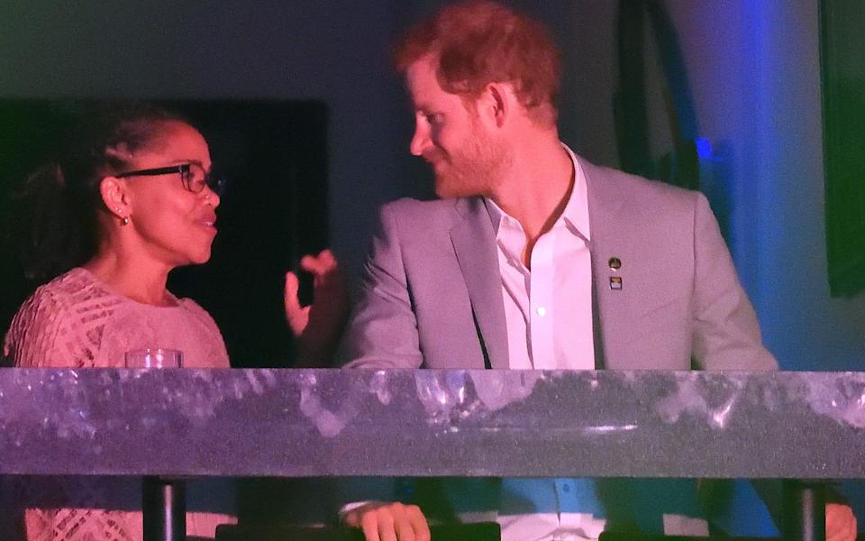 Prince Harry with Meghan Markle's mother, Doria Ragland, at The Invictus Games in Canada in September - The Mega Agency