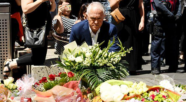 Malcolm Turnbull left flowers at the tribute site on Bourke Street. Photo: AAP