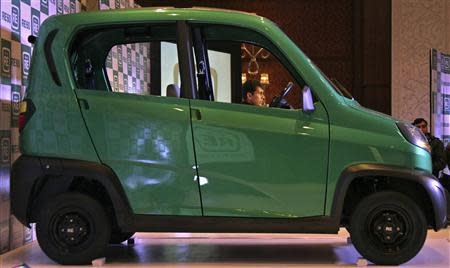Bajaj's Managing Director Rajiv Bajaj is seen through the windows of the newly launched four-wheeled RE60 in New Delhi in this January 3, 2012 file photo. REUTERS/B Mathur/Files