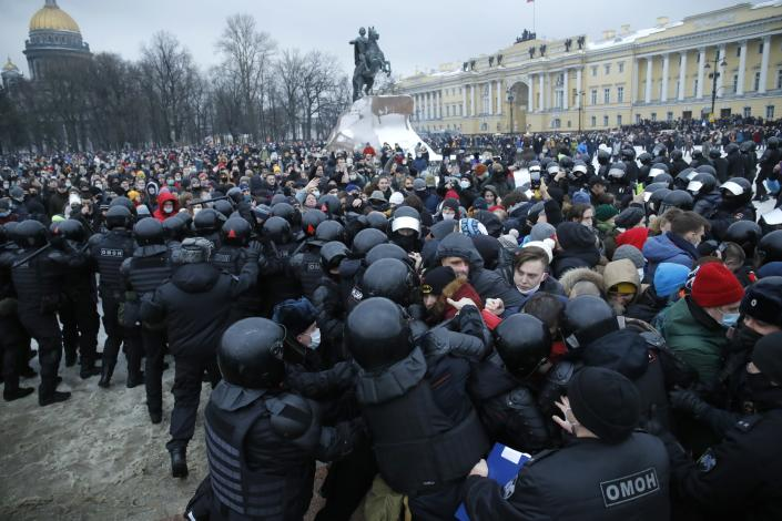 FILE - In this Jan. 23, 2021, file photo, people clash with police during a protest against the jailing of opposition leader Alexei Navalny in St.Petersburg, Russia. Allies of Navalny are calling for new protests next weekend to demand his release, following a wave of demonstrations across the country that brought out tens of thousands in a defiant challenge to President Vladimir Putin. (AP Photo/Dmitri Lovetsky, File)