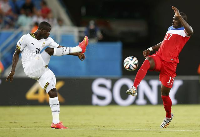 Ghana's Jonathan Mensah fights for the ball against Jozy Altidore of the U.S. during their 2014 World Cup Group G soccer match at the Dunas arena in Natal June 16, 2014. REUTERS/Toru Hanai (BRAZIL - Tags: SOCCER SPORT WORLD CUP)
