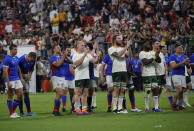 South African and Namibian players gesture tot he crowd following their Rugby World Cup Pool B game at the City of Toyota Stadium between South Africa and Namibia in Toyota City, Japan, Saturday, Sept. 28, 2019. South Africa defeated Namibia 57-3. (AP Photo/Christophe Ena)