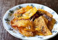 """Photo: Partial Ingredients<br> Baked Butternut Squash Chips<br><br> Emily brings back her favorite flavors of fall with these satisfying baked butternut squash chips scented with fragrant sage. Healthy snacks just went haute.<br><br> Recipe: <a href=""""http://www.partial-ingredients.com/archives/3898#"""" rel=""""nofollow noopener"""" target=""""_blank"""" data-ylk=""""slk:Baked Butternut Squash Chips"""" class=""""link rapid-noclick-resp"""">Baked Butternut Squash Chips</a>"""