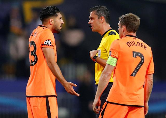 Soccer Football - Champions League - Maribor vs Liverpool - Ljudski vrt, Maribor, Slovenia - October 17, 2017 Referee Viktor Kassai talks with Liverpool's Emre Can REUTERS/Srdjan Zivulovic