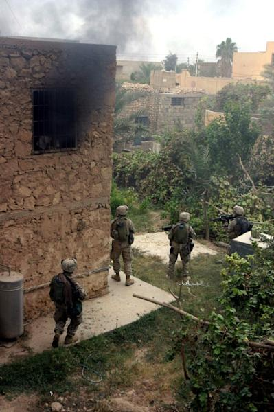US marines carry out searches in the Iraqi insurgent bastion of Al-Qaim during Operation Steel Curtain on 15 November, 2005
