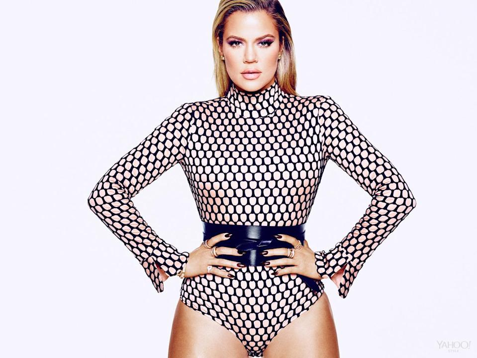 """<p>Khloé's reputation for the being the funniest member of the Kardashian Jenner clan is well deserved. """"Sometimes I talk too much. I'm just … very honest,"""" she says. """"I've also had people be like 'Oh my God, you're so funny, will you tell me a joke?' And I'm like 'I'm not Kathy Griffin!' As much as I wish I could, I don't do stand-up."""" </p><p>Véronique Leroy Blush & Black Meshed Bodysuit, $822, <a href=""""http://openingceremony.us/ocsearch.asp?keyword=veronique%20leroy"""" rel=""""nofollow noopener"""" target=""""_blank"""" data-ylk=""""slk:openingceremony.us"""" class=""""link rapid-noclick-resp"""">openingceremony.us</a><br></p><p><i>Isabel Marant Dudley Leather Belt, $420, <a href=""""http://www.net-a-porter.com/us/en/product/606590?cm_mmc=ProductSearchUS_PLA_c-_-Isabel%20Marant-_-Accessories-Belts-Wide-_-83331735874_606590-304&gclid=CJaCsbTD6sgCFYkWHwodttUGUg"""" rel=""""nofollow noopener"""" target=""""_blank"""" data-ylk=""""slk:net-a-porter.com"""" class=""""link rapid-noclick-resp"""">net-a-porter.com</a><br>SHAY Baugette Orbit Ring in 18k Gold and Diamonds,$7,560, <br><a href=""""http://www.shayfinejewelry.com/"""" rel=""""nofollow noopener"""" target=""""_blank"""" data-ylk=""""slk:shayfinejewelry.com"""" class=""""link rapid-noclick-resp"""">shayfinejewelry.com</a><br>SHAY Essential Orbit Ring in 18k Gold and Diamond Orbit Ring, $5,460, <a href=""""http://www.shayfinejewelry.com/"""" rel=""""nofollow noopener"""" target=""""_blank"""" data-ylk=""""slk:shayfinejewelry.com"""" class=""""link rapid-noclick-resp"""">shayfinejewelry.com</a><br>SHAY 5 Row Closed Mixed Diamond Ring, $7,140, <a href=""""http://www.shayfinejewelry.com/"""" rel=""""nofollow noopener"""" target=""""_blank"""" data-ylk=""""slk:shayfinejewelry.com"""" class=""""link rapid-noclick-resp"""">shayfinejewelry.com</a><br>SHAY Essential Pave Link Barcelet, $16,380, <a href=""""http://www.shayfinejewelry.com/"""" rel=""""nofollow noopener"""" target=""""_blank"""" data-ylk=""""slk:shayfinejewelry.com"""" class=""""link rapid-noclick-resp"""">shayfinejewelry.com</a><br>SHAY Essential Link Pavé ID Bracelet in 18K Gold and Diamonds, $10,080, <a href=""""http://www.shayfine"""