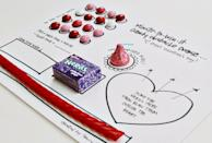 """<p>When it's a quick game that features all types of sweets, you know everyone will want to play.</p><p><strong>Get the tutorial at <a href=""""https://www.stacyjulian.com/blog/2016/2/1/minute-to-win-it-valentine-style"""" rel=""""nofollow noopener"""" target=""""_blank"""" data-ylk=""""slk:Stacy Julian"""" class=""""link rapid-noclick-resp"""">Stacy Julian</a>.</strong></p><p><strong><a class=""""link rapid-noclick-resp"""" href=""""https://www.amazon.com/Hersheys-Kisses-Valentines-Chocolate-Pound/dp/B01N1659IA?tag=syn-yahoo-20&ascsubtag=%5Bartid%7C10050.g.25916974%5Bsrc%7Cyahoo-us"""" rel=""""nofollow noopener"""" target=""""_blank"""" data-ylk=""""slk:SHOP HERSHEY'S KISSES"""">SHOP HERSHEY'S KISSES</a><br></strong></p>"""