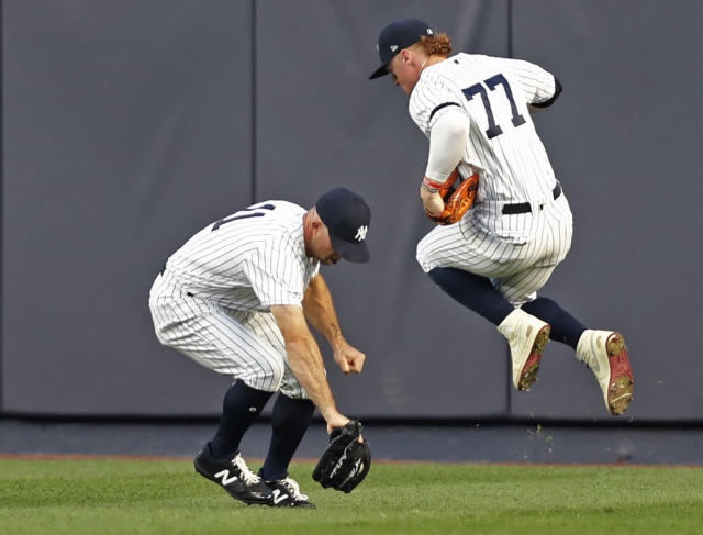 New York Yankees right fielder Clint Frazier (77) leaps to allow Yankees center fielder Brett Gardner (11) to field an RBI single by New York Mets' Michael Conforto during the third inning of a baseball game Tuesday, June 11, 2019, in New York. (AP Photo/Kathy Willens)
