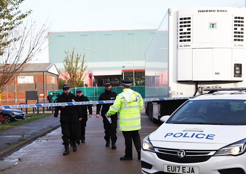 THURROCK, ENGLAND - OCTOBER 24: Police officers are seen at the scene where 39 bodies discovered in the back of a lorry on October 24, 2019 in Thurrock, England. The lorry was discovered early Wednesday morning in Waterglade Industrial Park on Eastern Avenue in the town of Grays. (Photo by Li Shanghao/China News Service/VCG via Getty Images)
