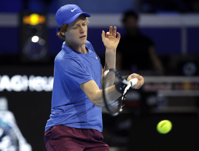 Jannic Sinner of Italy, returns the ball to Miomir Kecmanovic of Serbia, during the ATP Next Gen tennis tournament semifinal match, in Milan, Italy, Friday, Nov. 8, 2019. (AP Photo/Luca Bruno)