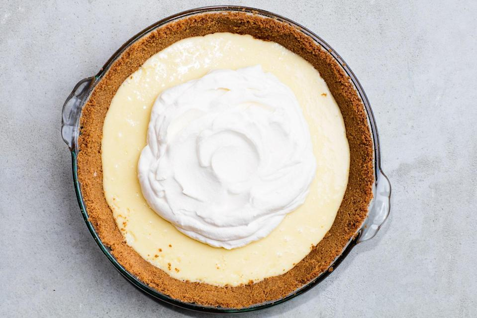 """This simple, four-ingredient pie has a bright and tangy yet sweet and creamy filling. <a href=""""https://www.epicurious.com/recipes/food/views/nellie-and-joes-key-lime-pie?mbid=synd_yahoo_rss"""" rel=""""nofollow noopener"""" target=""""_blank"""" data-ylk=""""slk:See recipe."""" class=""""link rapid-noclick-resp"""">See recipe.</a>"""