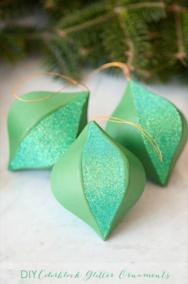 """<p>Add paint and glitter to these fun shapes for a simple (but lovely!) ornament. It'll look like you worked a whole lot harder than you did!</p><p><strong>Get the tutorial at <a href=""""https://thesweetestoccasion.com/2013/12/diy-colorblock-glitter-ornaments/"""" rel=""""nofollow noopener"""" target=""""_blank"""" data-ylk=""""slk:The Sweetest Occasion"""" class=""""link rapid-noclick-resp"""">The Sweetest Occasion</a>.</strong></p><p><a class=""""link rapid-noclick-resp"""" href=""""https://www.amazon.com/Glitter-Teenitor-Painting-Scrapbooking-Assorted/dp/B07JPF9T9X/?tag=syn-yahoo-20&ascsubtag=%5Bartid%7C10050.g.28831556%5Bsrc%7Cyahoo-us"""" rel=""""nofollow noopener"""" target=""""_blank"""" data-ylk=""""slk:SHOP CRAFT GLITTER"""">SHOP CRAFT GLITTER</a></p>"""