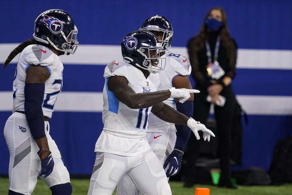 Tennessee Titans wide receiver A.J. Brown (11) celebrates a touchdown against the Indianapolis Colts in the first half of an NFL football game in Indianapolis, Sunday, Nov. 29, 2020. (AP Photo/Darron Cummings)