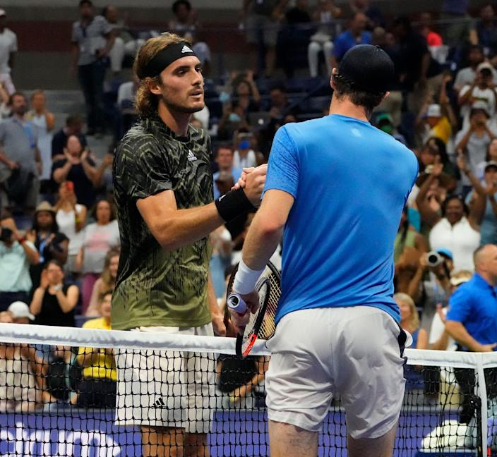 Andy Murray, right, wasn't happy about the length of a length of a bathroom break taken by Stefanos Tsitsipas.