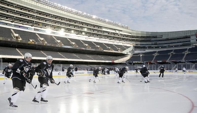 The Pittsburgh Penguins practice on the Soldier Field ice for Saturday's Stadium Series NHL hockey game between the Penguins and the Chicago Blackhawks, Friday, Feb. 28, 2014, in Chicago. (AP Photo/Charles Rex Arbogast)