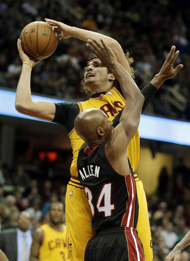 Cleveland Cavaliers' Anderson Varejao, from Brazil, shoots against Miami Heat's Ray Allen (34) in the first quarter of an NBA basketball game Wednesday, Nov. 27, 2013, in Cleveland. (AP Photo/Mark Duncan)