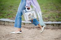 """<p>Aimee Song carries """"Madame Bovary"""" inside a clear Staud tote. (Photo: Getty Images) </p>"""