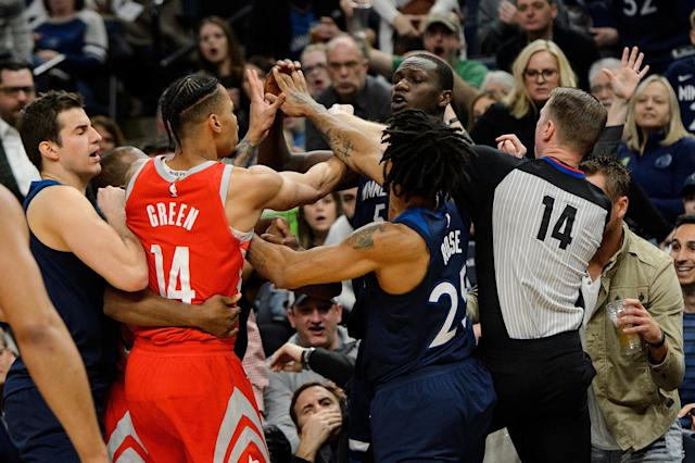 MINNEAPOLIS, MN - MARCH 18: Gerald Green #14 of the Houston Rockets gets into a altercation with Gorgui Dieng #5 of the Minnesota Timberwolves and Derrick Rose #25 and referee Ed Malloy #14 get in between them during the fourth quarter of the game on March 18, 2018 at the Target Center in Minneapolis, Minnesota. Green was ejected from the game. (Photo by Hannah Foslien/Getty Images)