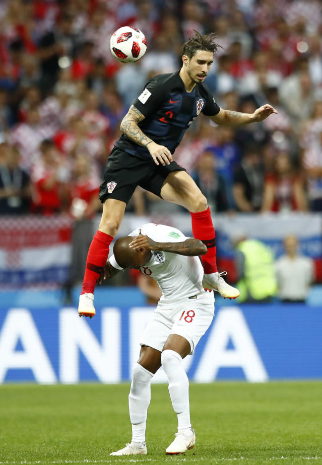<p>England's Ashley Young, down, and Croatia's Sime Vrsaljko, up, challenge for the ball during the semifinal match between Croatia and England at the 2018 soccer World Cup in the Luzhniki Stadium in Moscow, Russia, Wednesday, July 11, 2018. (AP Photo/Matthias Schrader) </p>