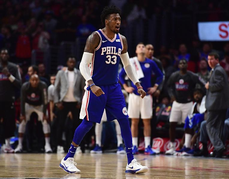 Robert Covington of the Philadelphia 76ers was hurt trying to save the ball out of bounds with 68 seconds remaining against the Cleveland Cavaliers and did not return (AFP Photo/Harry How)