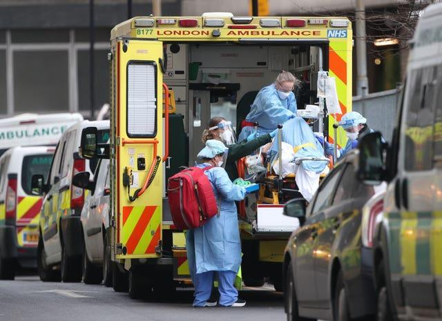 Paramedics and hospital staff attend to a patient outside the Royal London Hospital