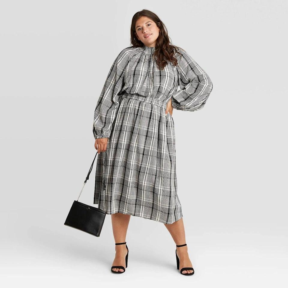 """<h2>Target A New Day Long Sleeve Smocked Dress</h2><br>Ever since they started their cultishly-beloved designer collaboration series over 20 years ago, big-box shop Target has been a go-to for affordable design — and the offerings from their in-house brands are no exception. This plaid fall frock boasts a luxury-look and a <em>well</em>-under-$100 price tag, plus an inclusive size range of XS - 4X.<br><br><strong>A New Day</strong> Long Sleeve Smocked Dress, $, available at <a href=""""https://go.skimresources.com/?id=30283X879131&url=https%3A%2F%2Fgoto.target.com%2F7A6JY"""" rel=""""nofollow noopener"""" target=""""_blank"""" data-ylk=""""slk:Target"""" class=""""link rapid-noclick-resp"""">Target</a>"""