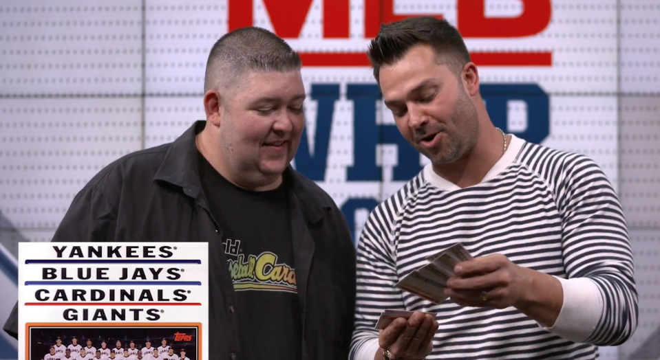 Former MLB star and current Fox Sports analyst Nick Swisher opens baseball cards from 1982 and 2004. (Yahoo Sports)